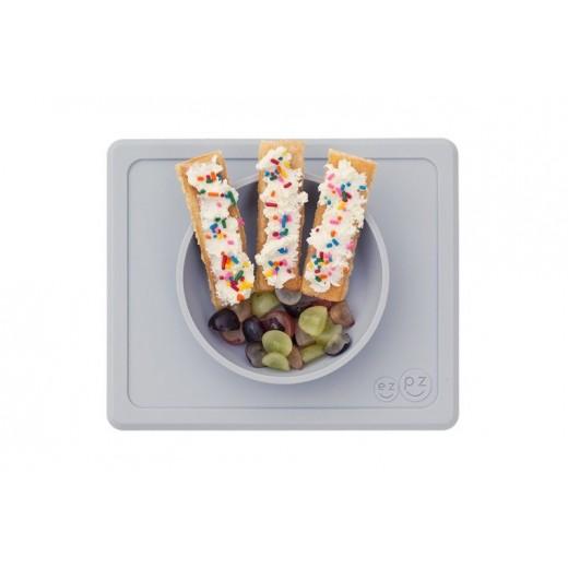 EZPZ Silikonowa miseczka z podkładką 2w1 Mini Bowl pastelowa szarość